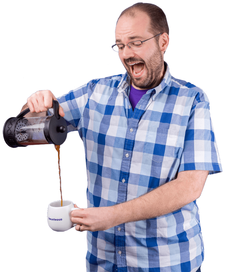 Photo of Steve pouring a french press of coffee precariously into a mug and smiling